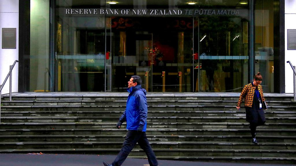 FILE PHOTO: FILE PHOTO: Pedestrians walk near the main entrance to the Reserve Bank of New Zealand located in central Wellington, New Zealand