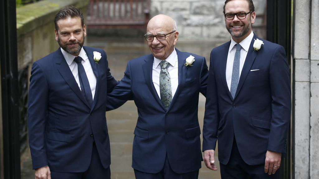 Media Mogul Rupert Murdoch poses for a photograph with his sons Lachlan and James as they arrive at St Bride''s church for a service to celebrate the wedding between Murdoch and former supermodel Jerry Hall in London