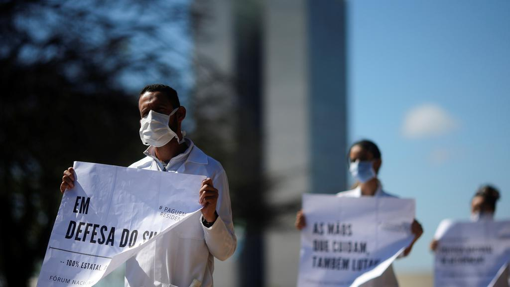 Resident doctors protest against the lack of salaries'' payment in front of the Ministry of Health, amid the coronavirus disease (COVID-19) outbreak, in Brasilia