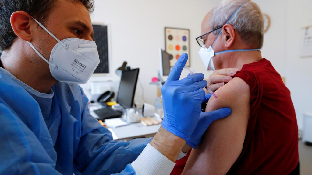 General practitioner vaccinates dose of the AstraZeneca coronavirus disease (COVID-19) vaccine in a doctors practice in Berlin