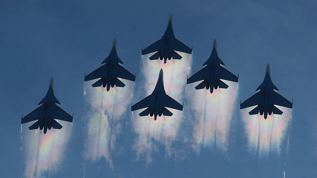 Sukhoi Su-30SM and Su-35 jet fighters of the Russian Knights aerobatic team perform during International military-technical forum