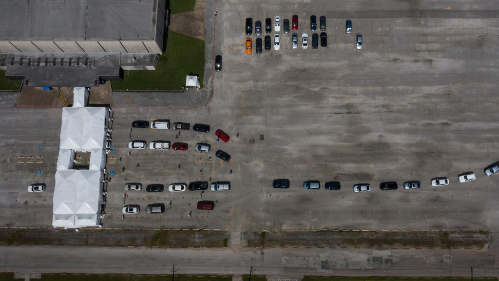 Residents line-up in vehicles to be tested amid global outbreak of coronavirus disease in Houston, Texas