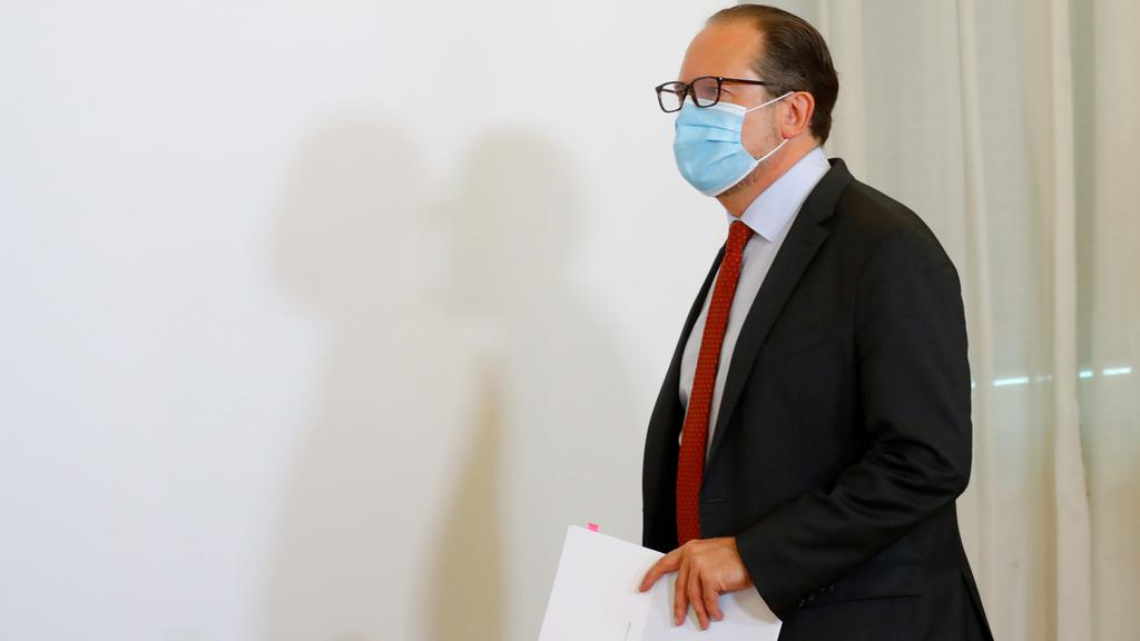 FILE PHOTO: Austrian Foreign Minister Schallenberg arrives for a news conference in Vienna