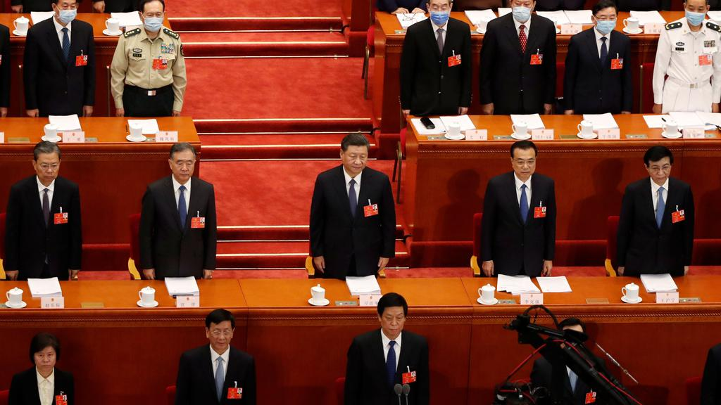 Chinese President Xi Jinping and officials attend the opening session of NPC in Beijing
