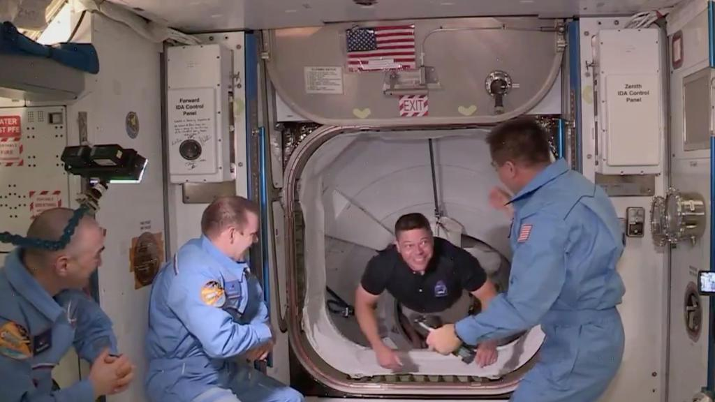 NASA astronaut Bob Behnken arrives at the International Space Station aboard SpaceX''s Crew Dragon capsule in this still image taken from video