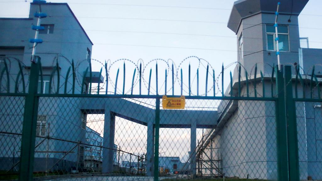 FILE PHOTO: A perimeter fence is constructed around what is officially known as a vocational skills education centre in Dabancheng