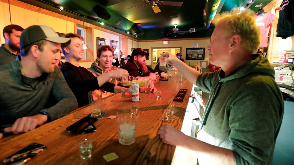 Owner Michael Mattson toasts the re-opening of the Friends and Neighbors bar in Appleton