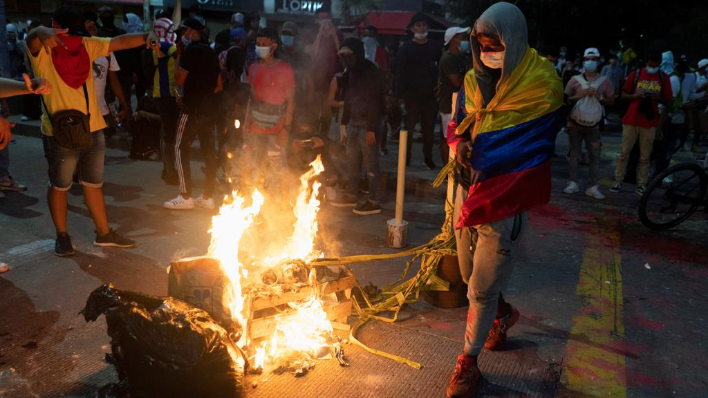 Demonstrators gather around a burning barricade during a protest against a Copa Libertadores soccer match, in Barranquilla