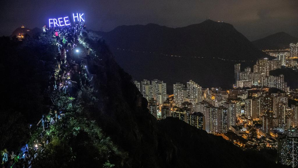FILE PHOTO: Anti-government protesters gather at Lion Rock, in Hong Kong