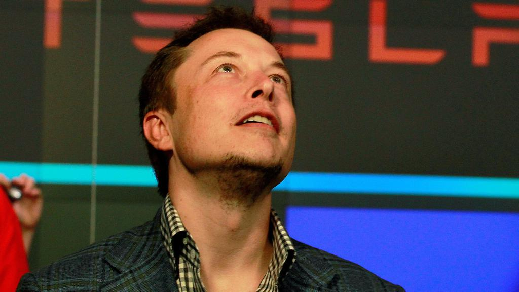 FILE PHOTO: CEO of Tesla Motors Elon Musk reacts following the company''s initial public offering at the NASDAQ market in New York