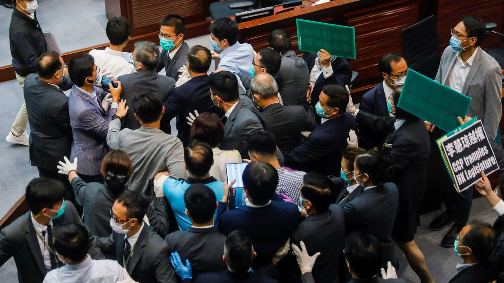 Pan-democratic legislators scuffle with security as they protest against new security laws during Legislative Council''s House Committee meeting, in Hong Kong