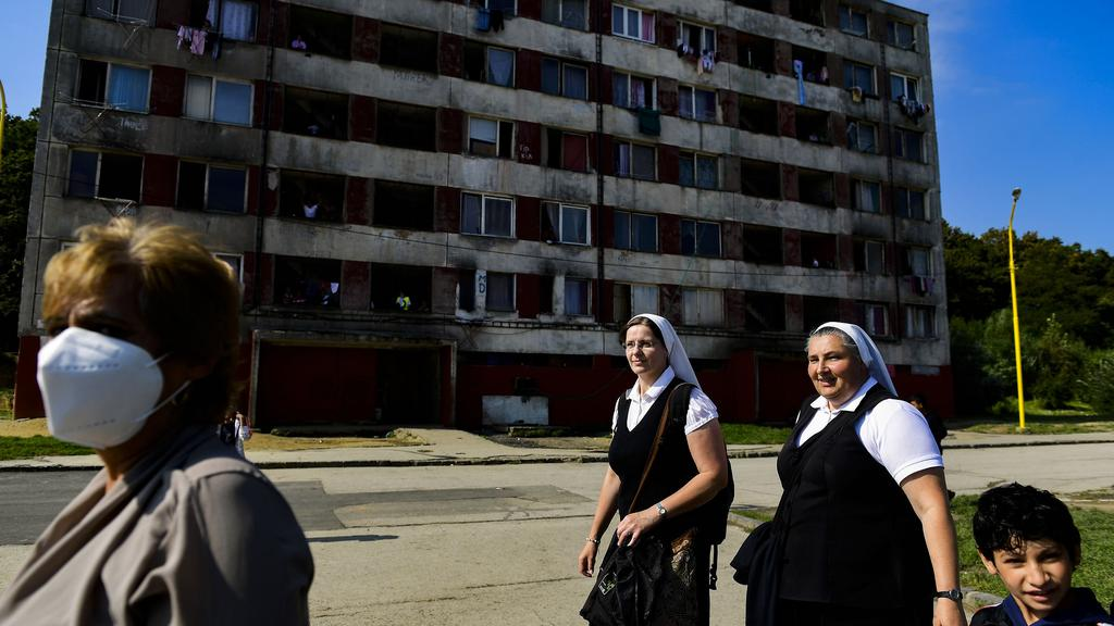 Local people watch the Pope Francis in housing estate Lunik IX in Kosice