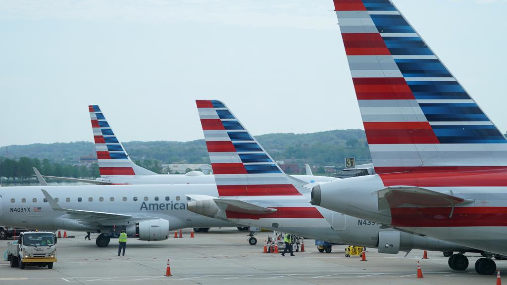 FILE PHOTO: American Airlines jets sit at gates at Washington''s Reagan National airport in Washington